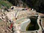 Réalisation d'une piscine et de murs de soutènement en moellons de pierre à St Maurice en Chalencon (Ardèche) en 2007
