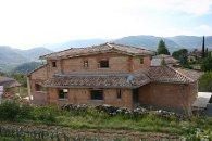 Maison d'habitation en brique de terre cuite R37 à la fin de la construction - Coux (Ardèche) en 2008